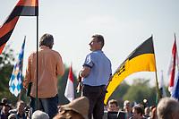 """200 bis 300 Reichsbuerger, Neonazis, Antisemiten und Verschwoerungstheoretiker versammelten sich am 3. Oktober 2014 zu einem """"Sturm auf den Reichstag"""". Die sogenannten Reichsbuerger erkennen die hiesigen Gesetze und Institutionen nicht an. Deutschland sei 1945 nicht befreit sondern besetzt worden und Grenzen des Deutschen Reiches von 1937 wuerden immer noch gelten. Anhaenger dieser Gruppierung fallen immer wieder durch Holocaustleugnung und Volksverhetzung auf.<br /> Zu den Kundgebungsteilnehmern sprach neben bekennenden Rechten auch der deutsche Pop- und Schlagersaenger Xavier Naidoo.<br /> Rechts im Bild: Der selbsternannte Reichsbuerger Ruediger Hoffmann (alias Ruediger Klasen). Hoffmann war ehem. NPD-Chef in Hagenow und hat wegen einem Brandanschlag auf eine Fluechtlingsunterkunft 3 Jahre in Haft gesessen.<br /> 3.10.2014, Berlin<br /> Copyright: Christian-Ditsch.de<br /> [Inhaltsveraendernde Manipulation des Fotos nur nach ausdruecklicher Genehmigung des Fotografen. Vereinbarungen ueber Abtretung von Persoenlichkeitsrechten/Model Release der abgebildeten Person/Personen liegen nicht vor. NO MODEL RELEASE! Don't publish without copyright Christian-Ditsch.de, Veroeffentlichung nur mit Fotografennennung, sowie gegen Honorar, MwSt. und Beleg. Konto: I N G - D i B a, IBAN DE58500105175400192269, BIC INGDDEFFXXX, Kontakt: post@christian-ditsch.de<br /> Urhebervermerk wird gemaess Paragraph 13 UHG verlangt.]"""