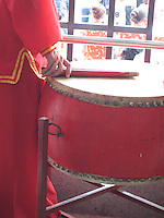 A Chinese drum is played at a traditional ceremony