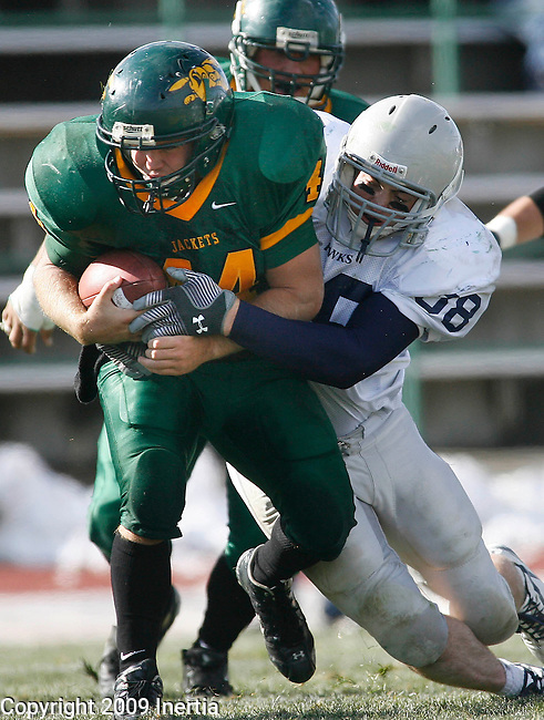 SPEARFISH, SD - OCTOBER 10, 2009 --   Cole Benne #44 of Black Hills State gets tackled by Bodie Tobin #38 of Dickinson State during their  game at Lyle Hare Stadium in Spearfish Saturday. (Photo by Dick Carlson/Inertia)