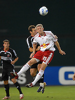 New York Red Bulls John Wolyniec (15) heads the ball while covered by DC United defender Greg Vanney (6). DC United defeated the New York Red Bulls 3-1, at RFK Stadium in Washington DC, Thursday August  22, 2007.