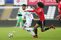 Sunday 18 March 2018<br /> Pictured:  Kenji Gorre of Swansea City is challenged by Tahith Chong of Manchester United<br /> Re: Swansea City v Manchester United U23s in the Premier League 2 at The Liberty Stadium on March 18, 2018 in Swansea, Wales.