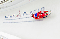 5 December 2014:  Florian Gruber and Kainzwaldner Simon, sliding for Italy, bank into Curve 10 on their second run, ending the day with a 15th place finish and a combined 2-run time of 1:29.545 in the Men's Doubles Competition at the Viessmann Luge World Cup, at the Olympic Sports Track in Lake Placid, New York, USA. Mandatory Credit: Ed Wolfstein Photo *** RAW (NEF) Image File Available ***