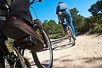 Man's legs pedaling on a mountain bike, Vitrolles, Provence, France.