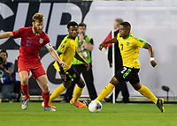 NASHVILLE, TN - JULY 3: Leon Bailey #7 dribbles the ball as Tim Ream #13 defends during a game between Jamaica and USMNT at Nissan Stadium on July 3, 2019 in Nashville, Tennessee.