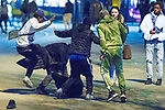 © Joel Goodman - 07973 332324 . 07/04/2017 . Manchester , UK . 5th in a sequence . Five youths on one as a fight breaks out in which a man's head is kicked and stamped upon , in Piccadilly Gardens . Greater Manchester Police have authorised dispersal powers and say they will ban people from the city centre for 48 hours , this evening (7th April 2017) , in order to tackle alcohol and spice abuse . Photo credit : Joel Goodman