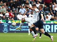 25th September 2021; Swansea.com Stadium, Swansea, Wales; EFL Championship football, Swansea versus Huddersfield; Joel Piroe of Swansea City shoots to score his sides first goal making it 1-0 in the 18th minute