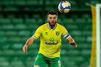 2nd January 2021; Carrow Road, Norwich, Norfolk, England, English Football League Championship Football, Norwich versus Barnsley; Grant Hanley of Norwich City prepares to head the ball carefully after suffering a head injury