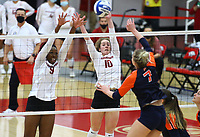 Auburn Junior Rebekah Rath (7) spikes the ball as Abigail Archibong (9) and  Jillian Gillen (10) of Arkansas go up for block on Sunday, Oct. 10, 2021, during play at Barnhill Arena, Fayetteville. Visit nwaonline.com/211011Daily/ for today's photo gallery.<br /> (Special to the NWA Democrat-Gazette/David Beach)
