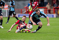 Matt Harrold of Crawley Town  slides in to tackle Garry Thompson of Wycombe Wanderers during the Sky Bet League 2 match between Crawley Town and Wycombe Wanderers at Checkatrade.com Stadium, Crawley, England on 29 August 2015. Photo by Liam McAvoy.