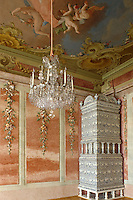 A large ceramic stove stands in the corner of an ornate stucco room decorated by sculptor Johann Michael Graff