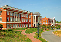 Photography of Charlotte NC's University of North Carolina at Charlotte campus (UNC Charlotte). UNCC, a public university located in northeast Charlotte, is part of the University of North Carolina higher education system. Opened in 1946, the campus has experienced explosive growth in recent years, including the addition of its Charlotte Research Institute campus and a football team. Photo shows Grigg Hall, home to the Charlotte Research Institute Campus, the Center for Optoelectronics and Optical Communications, and the UNCC physics department.