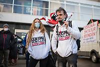"""Anlaesslich des ertsne Jahrestag der Coronamassnahmen der Bundesregierung protestierten etwas ueber 200 Menschen auf dem Berliner Alexanderplatz gegen die Politik der Bundesregierung. Sie forderten ein Ende der Maskenregelungen und Einschraenkungen in oeffentlichen Leben. Die Demonstranten riefen """"Liebe, Freiheit, Keine Diktatur"""" und """"Wahrheit macht Frei"""".<br /> Der Veranstalter, der Youtube-Schlagerstar Bjoern Winter alias Bjoern Banane, hatte 1000 Menschen zu der Kundgebung erwartet.<br /> Im Bild: Ein Demonstrantenpaar mit Pullovern mit dem Aufdruck """"Coronarebellen Duesseldorf"""". Sie traegt eine Mund-Nase-Schutzmaske mit der Filzstift-Aufschrift """"Bussgeldschutz"""".<br /> 13.3.2021, Berlin<br /> Copyright: Christian-Ditsch.de"""
