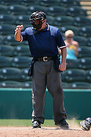 April 13, 2009:  Home plate umpire Matt Cunningham during a game at Hammond Stadium in Fort Myers, FL.  Photo by:  Mike Janes/Four Seam Images