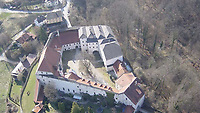BNPS.co.uk (01202 558833)<br /> Pic: IronCrossMagazine/BNPS<br /> <br /> Pictured: An aerial photograph of Castle Tittmoning.<br /> <br /> The comical escape attempts made by British officers from a German prisoner of war camp called Castle Tittmoning have been revealed 80 years later.<br /> <br /> The desperate efforts to break out of the little known but rude sounding camp included three men who hid inside a cramped fireplace for eight days before being found by guards covered in soot. <br /> <br /> Other officers hid under piles of rubbish on a horse-drawn cart and allowed themselves to be driven out of the fortress before they were discovered.<br /> <br /> The men expertly made German uniforms out of blankets and brazenly walked out of the camp disguised as guards before being rumbled.