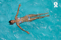 Teenager girl (15) floating in swimming pool (Licence this image exclusively with Getty: http://www.gettyimages.com/detail/83154232 )