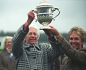 Nancy Getty hoists the Colonial Cup.