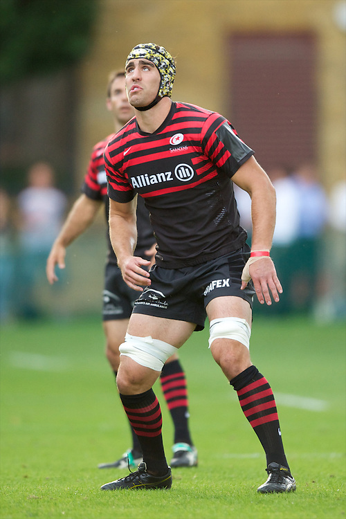 20120823 Copyright onEdition 2012©.Free for editorial use image, please credit: onEdition..Kelly Brown of Saracens in action at The Honourable Artillery Company, London in the pre-season friendly between Saracens and Stade Francais Paris...For press contacts contact: Sam Feasey at brandRapport on M: +44 (0)7717 757114 E: SFeasey@brand-rapport.com..If you require a higher resolution image or you have any other onEdition photographic enquiries, please contact onEdition on 0845 900 2 900 or email info@onEdition.com.This image is copyright the onEdition 2012©..This image has been supplied by onEdition and must be credited onEdition. The author is asserting his full Moral rights in relation to the publication of this image. Rights for onward transmission of any image or file is not granted or implied. Changing or deleting Copyright information is illegal as specified in the Copyright, Design and Patents Act 1988. If you are in any way unsure of your right to publish this image please contact onEdition on 0845 900 2 900 or email info@onEdition.com