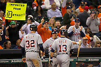 Detroit Tigers teammates and fans cheer catcher Alex Avila (13) after he hit a go-ahead two run home run in the ninth inning of the MLB baseball game against the Houston Astros on May 3, 2013 at Minute Maid Park in Houston, Texas. Detroit defeated Houston 4-3. (Andrew Woolley/Four Seam Images).