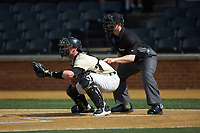 Wake Forest Demon Deacons catcher Shane Muntz (11) reaches for a pitch as Home plate umpire Tom Honec looks on during the game against the Virginia Cavaliers at David F. Couch Ballpark on May 19, 2018 in  Winston-Salem, North Carolina. The Demon Deacons defeated the Cavaliers 18-12. (Brian Westerholt/Four Seam Images)