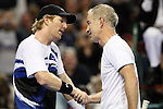 USA's Jim Courier (left) shakes hands with John McEnroe (right) after McEnroe won the match during the HSBC Tennis Cup series at First Niagara Center in Buffalo, NY on October 22, 2011