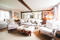 BNPS.co.uk (01202 558833)<br /> Pic: Cheffins/BNPS<br /> <br /> Pictured: There's a cosy sitting room<br /> <br /> Crime history fans can live in the home of notorious highwayman Dick Turpin for £1,950 a month.<br /> <br /> The infamous criminal ran a butcher's shop from this pretty thatched cottage before he joined a deer thief gang in the 1730s.<br /> <br /> Turpin was born opposite this house at the Bluebell Inn and staged cockfights in a grass area opposite the house which is still known as Turpin's ring.<br /> <br /> Robert Palmer bought the Grade II Listed Dick Turpin's Cottage in Hempstead, Essex, in 2012 and spent eight years gutting and refurbishing the house to make it more suitable for modern living.
