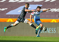 24th April 2021; Liberty Stadium, Swansea, Glamorgan, Wales; Rainbow Cup Rugby, Ospreys versus Cardiff Blues; Kirby Myhill of Cardiff Blues kicks forward under pressure from George North of Ospreys