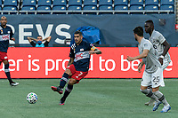 FOXBOROUGH, MA - SEPTEMBER 23: Gustavo Bou #7 of New England Revolution passes the ball during a game between Montreal Impact and New England Revolution at Gillette Stadium on September 23, 2020 in Foxborough, Massachusetts.