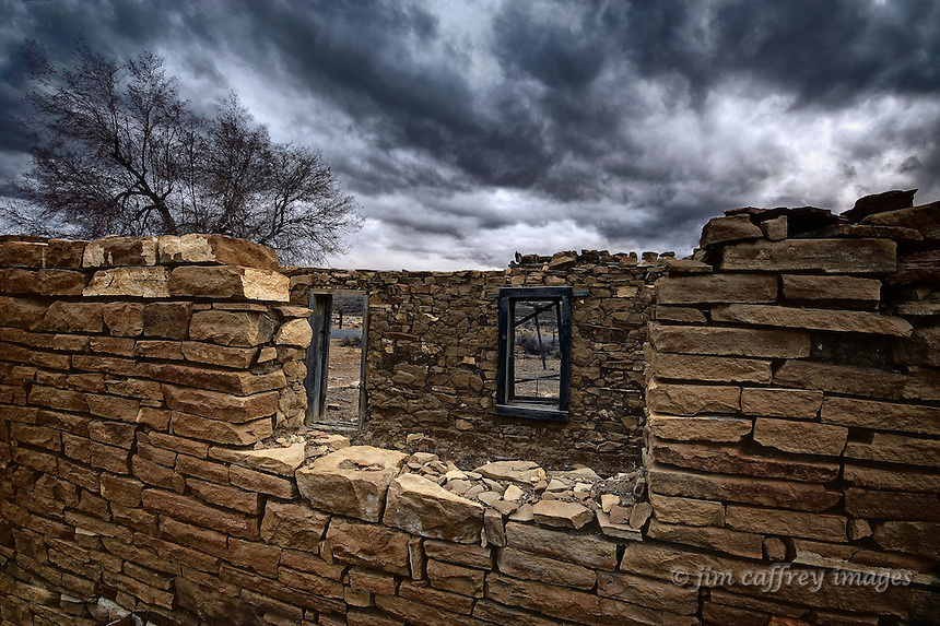 A stone ruin with no roof under a stormy sky near the village Torreon in the San Juan Basin of northwestern New Mexico.