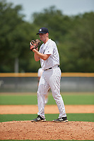 GCL Yankees East relief pitcher Dalton Higgins (58) gets ready to deliver a pitch during the first game of a doubleheader against the GCL Blue Jays on July 24, 2017 at the Yankees Minor League Complex in Tampa, Florida.  GCL Blue Jays defeated the GCL Yankees East 6-3 in a game that originally started on July 8th.  (Mike Janes/Four Seam Images)