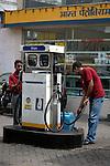 Indian ment working at a Bharat Petrolium petrol pump in Kolkata, West Bengal,  India  7/18/2007.  Arindam Mukherjee/Landov