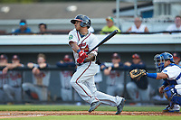 Willie Carter (15) of the Danville Braves follows through on his swing against the Burlington Royals at Burlington Athletic Stadium on July 13, 2019 in Burlington, North Carolina. The Royals defeated the Braves 5-2. (Brian Westerholt/Four Seam Images)