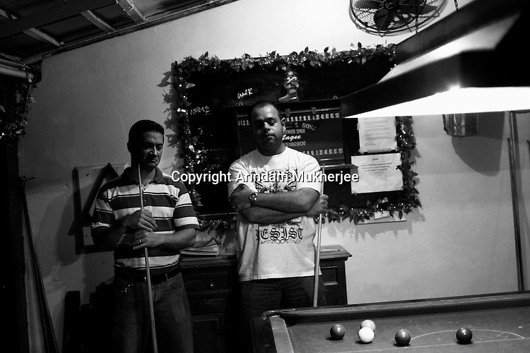 Michael and his friend playing billiard at the Rangers Club, administered and attended mainly by the Anglo Indians, in Kolkata.