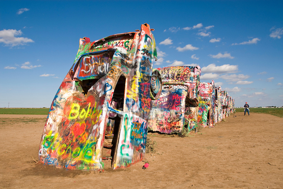 Cadillac Ranch automobile sculpture in the middle of a field