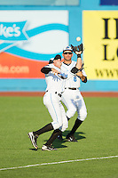 Hudson Valley Renegades second baseman Coty Blanchard (7) catches a fly ball down the right field line in front of Elias Torres (8) during the game against the Brooklyn Cyclones at Dutchess Stadium on June 18, 2014 in Wappingers Falls, New York.  The Cyclones defeated the Renegades 4-3 in 10 innings.  (Brian Westerholt/Four Seam Images)