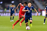 Doan Ritsu of Japan (R) competes for the ball with Raed Saleh of Oman (L) during the AFC Asian Cup UAE 2019 Group F match between Oman (OMA) and Japan (JPN) at Zayed Sports City Stadium on 13 January 2019 in Abu Dhabi, United Arab Emirates. Photo by Marcio Rodrigo Machado / Power Sport Images