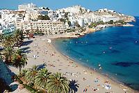 Spain. Ibiza in the Balearic islands. Ibiza. Tourists swimm, take a rest, sunbathe and sleep on a sandy beach in Ibiza City. Mediterranean sea. © 1999 Didier Ruef