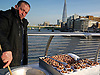 A food seller on the Millennium Bridge, London.<br /> <br /> Street food is ready-to-eat food or drink sold in a street or other public place, such as a market or fair, by a hawker or vendor, often from a portable food booth,[1] food cart or food truck. While some street foods are regional, many are not, having spread beyond their region of origin. Most street foods are also classed as both finger food and fast food, and are cheaper on average than restaurant meals. According to a 2007 study from the Food and Agriculture Organisation, 2.5 billion people eat street food every day.<br /> <br /> Stock Photo by Paddy Bergin