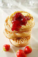 Strawberry jam on buttered crumpets stock photos
