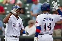 Round Rock Express outfielder Joey Butler #16 is greeted by teammate Robinson Chirinos #14 after he hit a home run against the New Orleans Zephyrs in the Pacific Coast League baseball game on April 21, 2013 at the Dell Diamond in Round Rock, Texas. Round Rock defeated New Orleans 7-1. (Andrew Woolley/Four Seam Images)