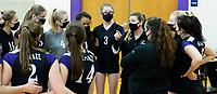 Waunakee head coach, Anne Denkert talks to players before the first set in Wisconsin WIAA girls high school volleyball regional finals on Saturday, Apr. 10, 2021 at DeForest High School