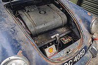 BNPS.co.uk (01202 558833)<br /> Pic: SilverstoneAuctions/BNPS<br /> <br /> Pictured: Under the front bonnet.<br /> <br /> A classic Porsche has emerged for sale after it was discovered in storage exactly as it was left over four decades ago.<br /> <br /> The 1964 3560C coup with its original blue paintwork is remarkably rare as most of its kind were scrapped after they were superseded by the more popular 911 model.<br /> <br /> Found by the seller in a barn where it languished since it was last driven in 1977, the car is a time capsule full of historic items left untouched for decades.