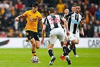 2nd October 2021;  Molineux Stadium, Wolverhampton,  West Midlands, England; EFL Cup football, Wolverhampton Wanderers versus Newcastle United; Sean Longstaff of Newcastle United tries to hold up a run by Raul Jimenez of Wolverhampton Wanderers