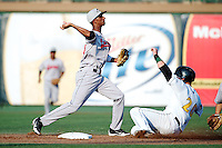 Great Lakes Loons Delvis Morales #8 attempts to turn a double play as Bryan Henry #20 slides in during a game against the South Bend Silverhawks at Coveleski Stadium on June 27, 2012 in South Bend, Indiana.  Great Lakes defeated South Bend 11-6  (Mike Janes/Four Seam Images)