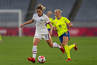 TOKYO, JAPAN - JULY 21: Abby Dahlkemper #17 of the USWNT passes during a game between Sweden and USWNT at Tokyo Stadium on July 21, 2021 in Tokyo, Japan.