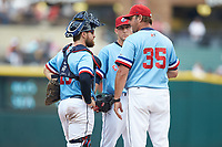 Columbus Clippers pitching coach Steve Karsay (35) has a meeting on the mound with relief pitcher Jeff Beliveau (38) and catcher Eric Haase (13) during the game against the Indianapolis Indians at Huntington Park on June 17, 2018 in Columbus, Ohio. The Indians defeated the Clippers 6-3.  (Brian Westerholt/Four Seam Images)
