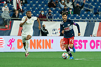 FOXBOROUGH, MA - MAY 1: Anton Walkes #4 of Atlanta United FC comes in to tackle Carles Gil #22 of New England Revolution during a game between Atlanta United FC and New England Revolution at Gillette Stadium on May 1, 2021 in Foxborough, Massachusetts.