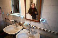 "SERBIA, Belgrade, Jan. 18, 2007..Julka Jaunkovic (73) refugee from Kosovo, Pec,  stands in a shared toilet in a refugee camp ""Krnjaca"" near Belgrade..© Djordje Jovanovic /EST&OST"