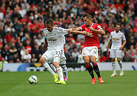 Pictured L-R: Gylfi Sigurdsson of Swansea against Adnan Januzaj of Manchester United. Saturday 16 August 2014<br /> Re: Premier League Manchester United v Swansea City FC at the Old Trafford, Manchester, UK.
