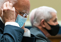 Dr. Robert Redfield, Director of the Centers for Disease Control and Prevention; adjusts his mask alongside Dr. AnthonyÜFauci (2nd-L), Director, National Institute for Allergy and Infectious Diseases, National Institutes of Health, during a House Energy and Commerce Committee hearing on the Trump Administration's Response to the COVID-19 Pandemic, on Capitol Hill in Washington, DC on Tuesday, June 23, 2020. <br /> Credit: Kevin Dietsch / Pool via CNP/AdMedia