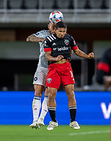 WASHINGTON, DC - MAY 13: Edison Flores #10 of D.C. United heads the ball during a game between Chicago Fire FC and D.C. United at Audi FIeld on May 13, 2021 in Washington, DC.